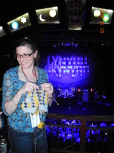 This is me, in 2011, knitting a pair of argyles 2-at-a-time, at a Lynyrd Skinner concert.  All the yarn I need for both socks is hanging from the needles.