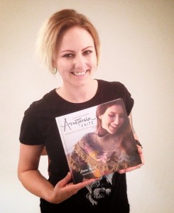 Chelsea Bowman worked with Bill this weekend on a photoshoot, doing make-up and hair (MUAH).  She also did the MUAH for Sara Olson, when we did the cover shoot for Annetarsia Knits.  Chelsea was thrilled to see the Book, finished, and Bill got a shot of her, holding it.