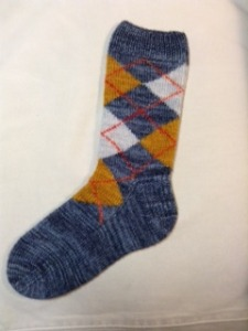 Kathi Doak was in the Argyle Socks class at Stitches East a mere two weeks ago, and has already knit her first full-sized sock!  She kindly sent me a photo and gave permission to share it with you.  I love the colors, which show off her exquisite knitting to perfection.  Great job, Kathi!  Now, just knit the second one :)