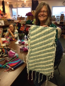 "Here, Kelly is showing the project from the side without the yarn supplies.  There is no real ""right"" or ""wrong"" side with garter stitch, of course!  Both sides are lovely."