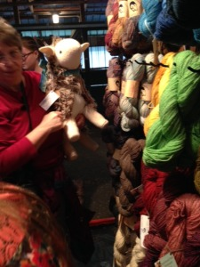 "Marcia Weinert and her new sheep, ""MacDugal"", trying to make their way through a crowded booth."