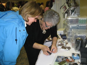 Elaine picking out the right beads for a project, at Madrona,