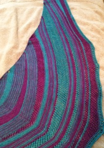 Here is Off-kilter, off the needles and blocking. The patterning is simple, just garter stitch and a basic mesh.  But the random short rows and changing of color create quite an interesting result (now that it is not crammed on the needles and I can see it!)
