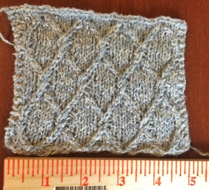 "Swatching for ""Chainmail"" sweater. Yarn is Simply Shetland silk & lambswool, in Shade 001. I love it a lot."