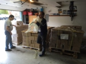 Sam and Randy are helping to unload and stack the boxes