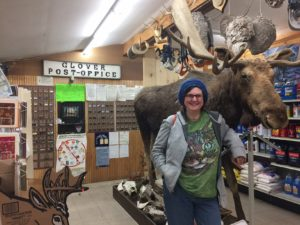 The Glover Post Office is located inside the store, near the full sized moose behind Donna.
