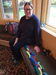 Jill with her butterflies laid out to knit in order. Fun!