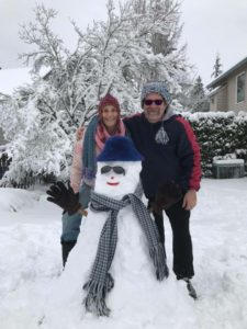 Anne and Bill wanted to build a snowman! Everything except Bill's coat and the snowman's gloves are knitted.